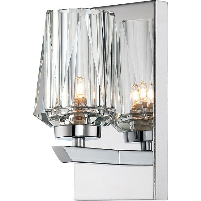 This contemporary bath light fixture features crystal glass shades accented with chrome-finished fixtures. Place two of these sconces on either side of your bathroom mirror to brighten your bathroom. A single 40-watt G9 Halogen bulb is included.