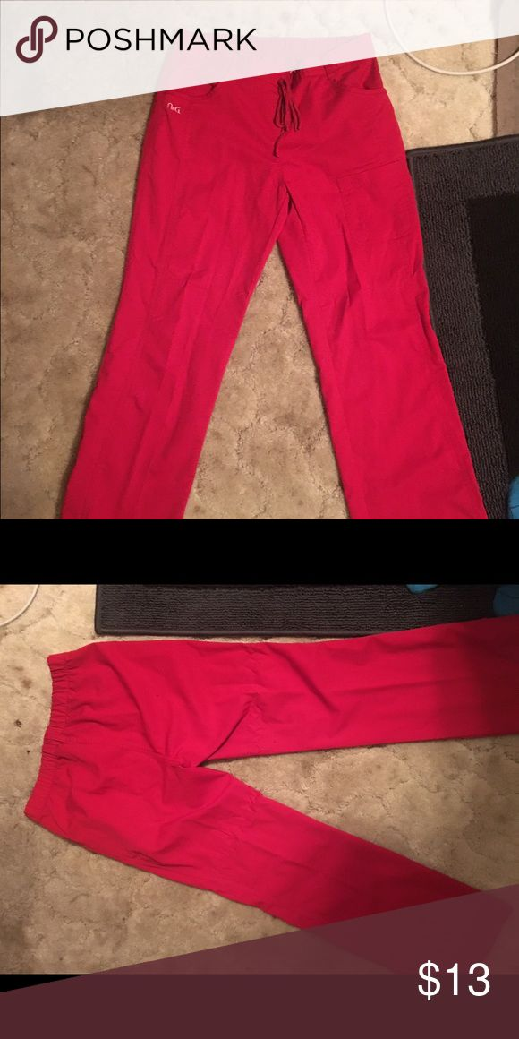 Red scrub pants Pair of small red NRG scrub pants. Soft, comfortable material. Worn very few times. Regular length. Pants