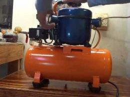 Silent Air Compressor - Homemade silent air compressor constructed from a surplus compressor tank, refrigerator compressor, check valve, and pressure switch.