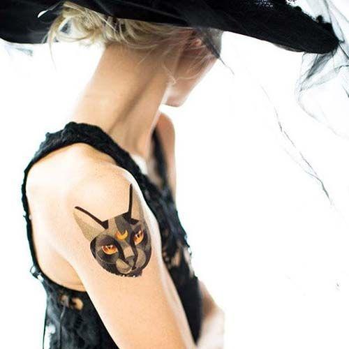 kadın üst kol kedi dövmesi woman upper arm cat tattoo