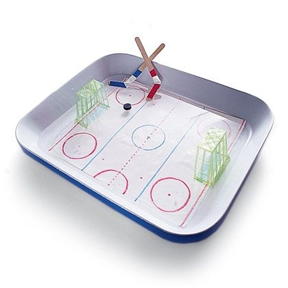 Tabletop Ice Hockey.   Make your own indoor miniature  rink, complete with real ice.  Goal is a berry basket cut in half. So stinkin' cute :o)