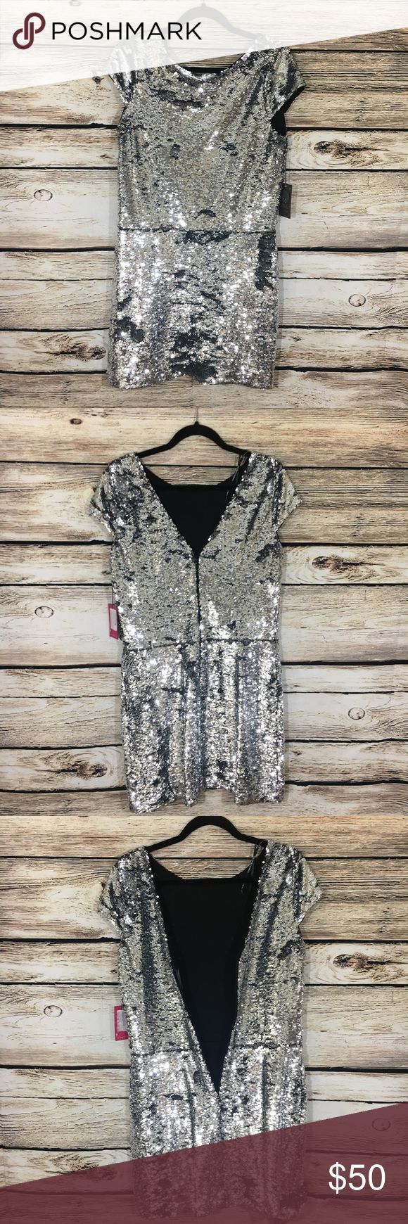 """Vince Camuto sequin silver mini party dress 10 Vince Camuto sequin, silver mini dress, perfect for any party or night out! It has a back seam zip, above knee length, women's size 10, bust 36"""", length 37"""" Vince Camuto Dresses Mini"""