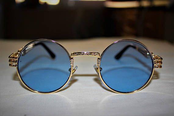 Lunettes de soleil design rappelle Gaultier, Matsuda. Cadre d'or, lentille bleu. Fabrication en Corée du Sud.