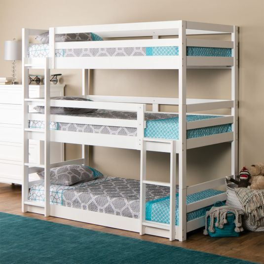 The Triple Decker triple twin bunk bed speaks for itself. Just look at the kid-capacity it offers. You'll easily have room for everyone with this space-saving design. The beds can also be separated into 3 individual twin beds or a double bunk bed and one twin bed. The white finish makes it easy t...