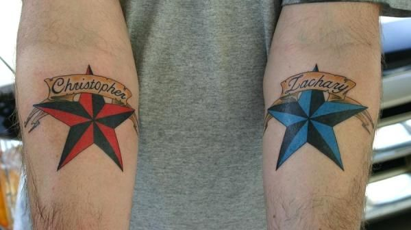 red n blue stars on hand 30 Awesome Star Tattoos For Men