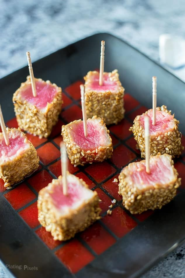 Sesame Seared Ahi Tuna Bites are a fresh and healthy party appetizer. Marinade in soy sauce, sesame oil and ginger, coat in sesame seeds and sear. Keep center rare and serve with toothpicks and dipping sauce. - www.platingpixels.com