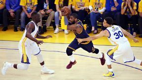 Kyrie Irving of Cleveland Cavaliers exits with apparent leg injury