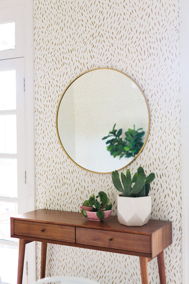 Our classic entry way favorites: the Metal Framed Round Wall Mirror, paired with the Mid-Century Console, seen here in Elsie's re-done dining room on A Beautiful Mess!