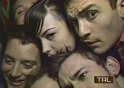 Elijah Wood,Liv Tyler, Orlando Bloom, Dominic Monaghan, Sean Astin (top left), and Billy Boyd (just his forehead)stuffed in a photo booth. ;)