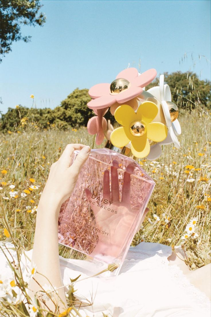 Marc Jacobs Daisy Eau So Fresh. Cutest bottle i've ever seen and the only one i liiike!