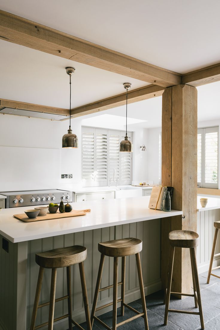 lovely exposed wooden beams in this big family kitchen by devol