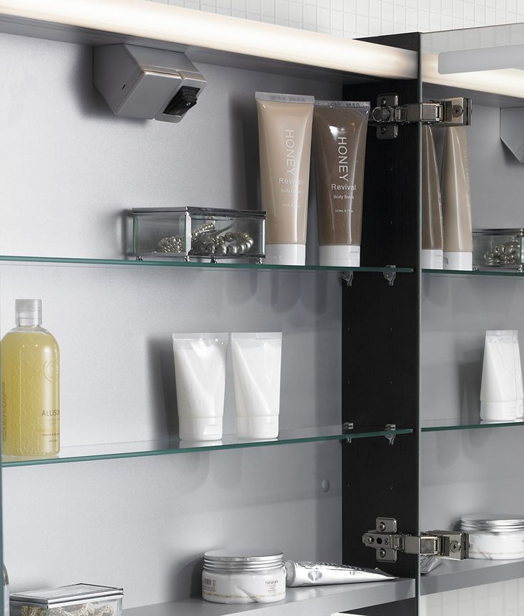 The Mido mirror cabinet has a shaver point and pull cord inside the cabinet. Its glass shelves can be moved around to suit.