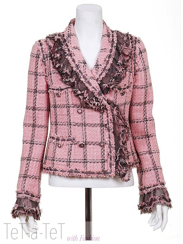 Chanel. Wool/cotton. I prefer much quieter and less fussy jackets, but this one is interesting in that the silk, lace and self-fringe cuffs can snap in or out. Note the sleeve/pocket-matching with the torso pattern.