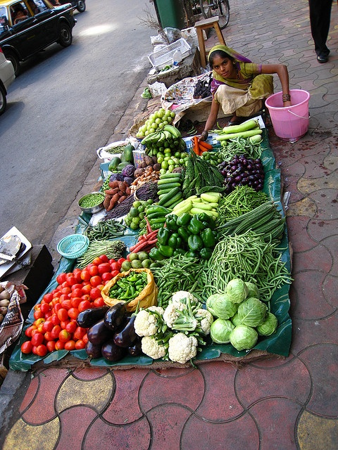 Street Vendor - Mumbai  I miss this! Always fresh veggies....and always super cheap!
