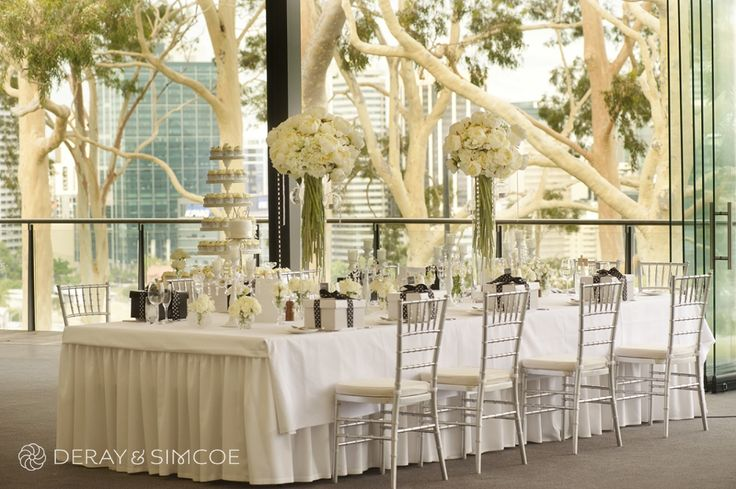 Tiffany chairs, white peonies and gifts for guests. Black and white color scheme. Classic and romantic wedding reception styling, ideas & inspiration. Wedding Reception at The State Reception Centre Kings Park, Perth Western Australia  Photography by DeRay & Simcoe