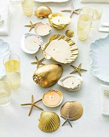 Velas con conchas y caracoles