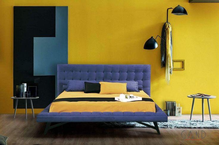 Κρεβάτι επενδυμένο με ύφασμα αδιάβροχο σε μπλε χρώμα με επεξεργασία καπιτονέ στο κεφαλάρι