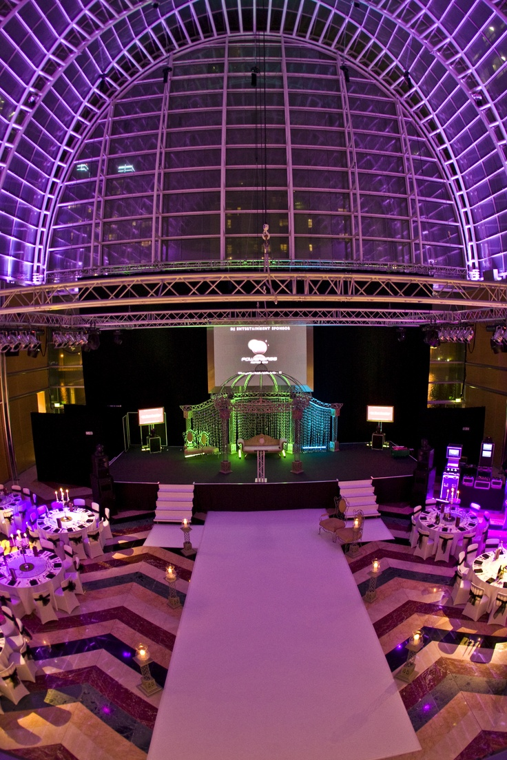 The perfect place to do some #Bollywood dancing! Glass roof and purple lights are a delicate yet stylish combination! check the floor pattern... beautiful! #Asianwedding photography by: Osman Ghani - Asian wedding #venues: http://www.yourdreamshaadi.co.uk/asianweddingdirectory.php
