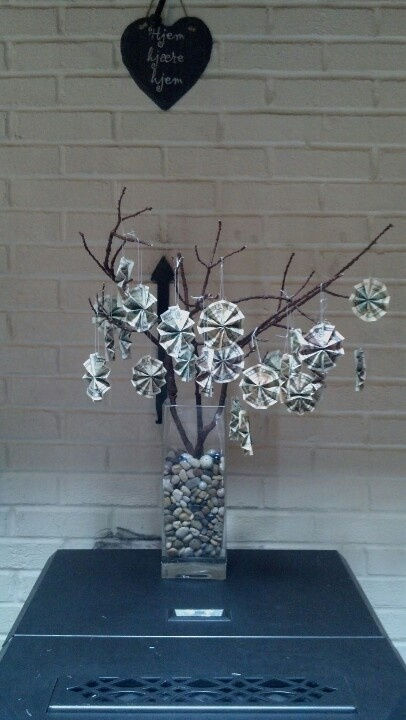 DIY money tree. 1) spray paint branches 2) fold money 3) hang on tree  Great gift ideas!!!!