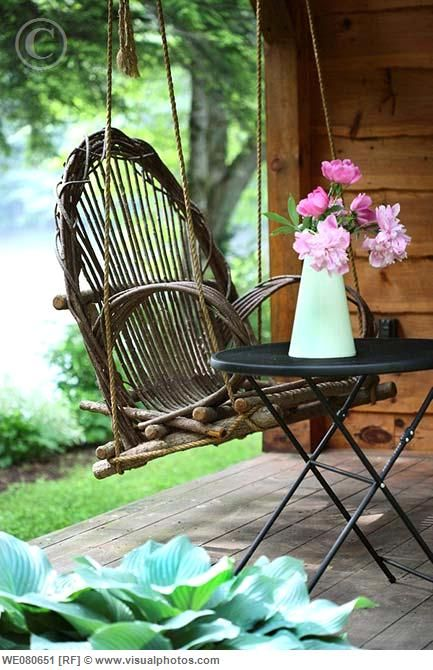 Adirondack swing on a porch ...ideal