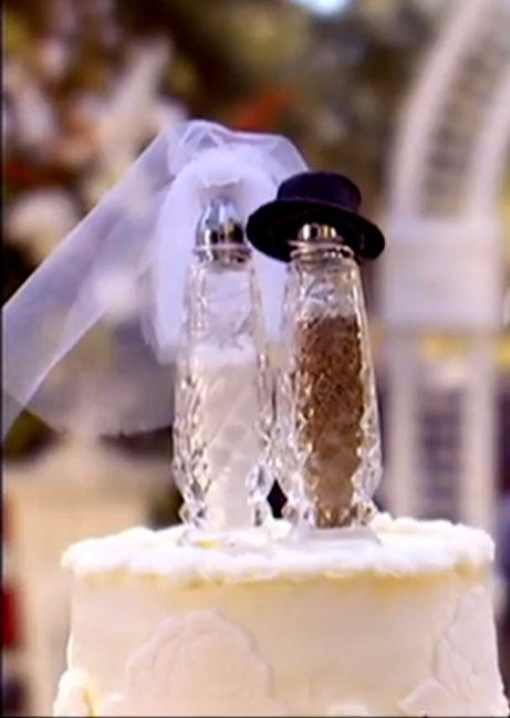 Fireproof cake topper ;) watch the movie Fireproof to understand why the salt and pepper shakers are on top. <3