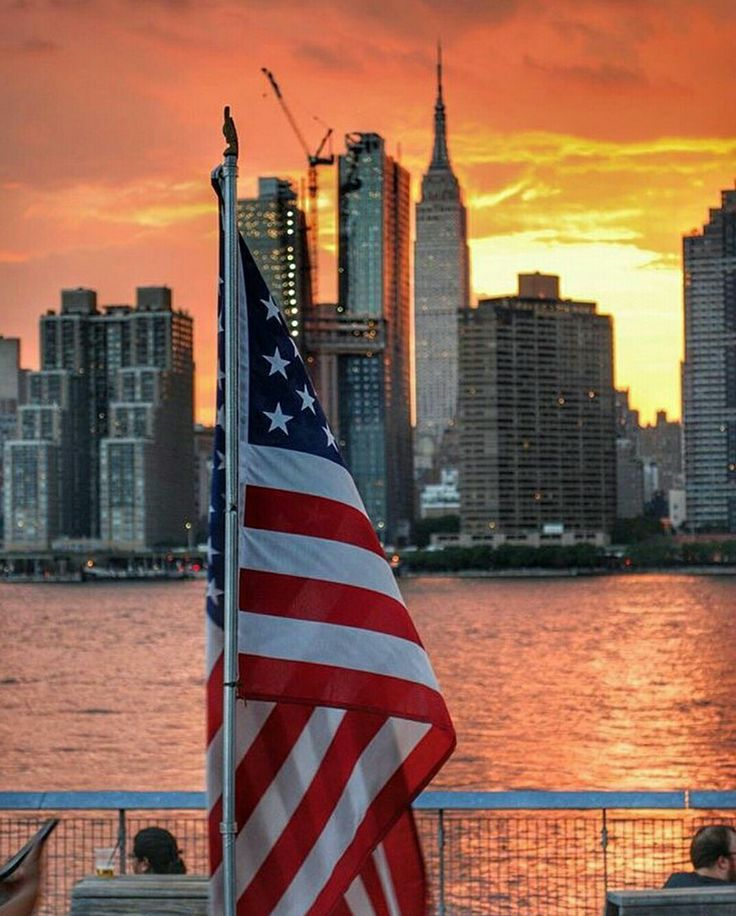 """BEAUTIFUL PICTURE OF N.Y.C IN THE BACK GROUND.....AND I SAY """"GOD"""" BLESS AMERICA."""