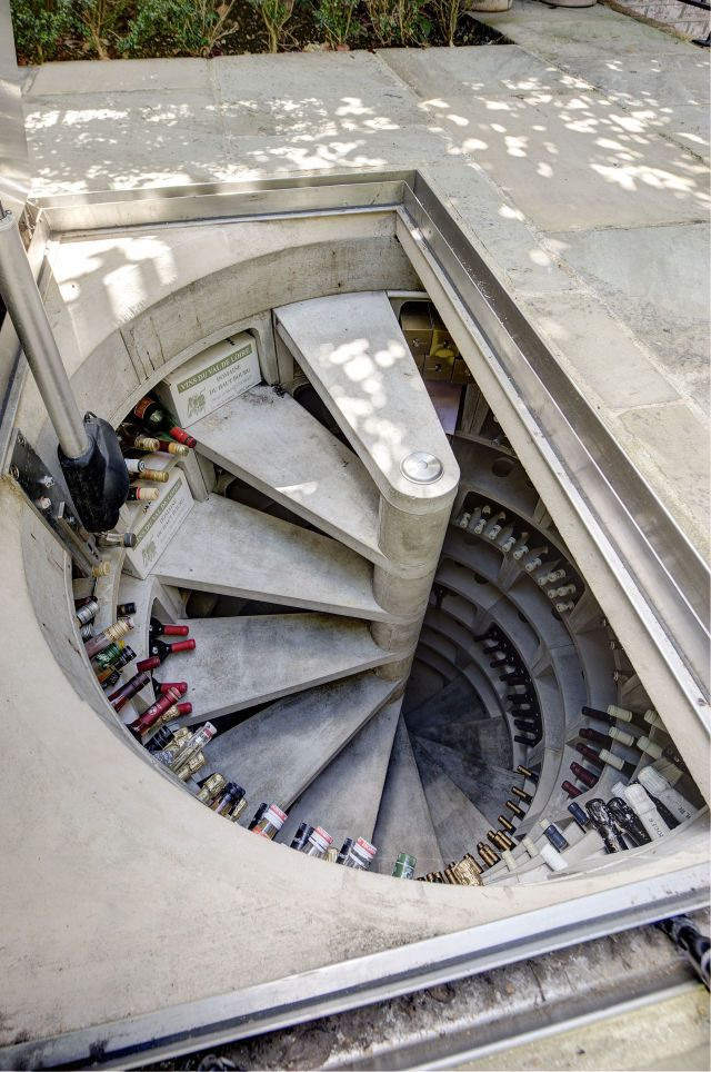This hidden spiral staircase wine cellar is an incredible use of space