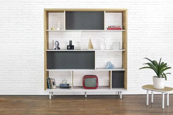 The playful dividing of the shelves makes the bookcase perfect to display different items
