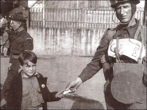 Liberation Day, May 9th, 1945.  A young boy in St. Peter Port receives a chocolate bar from a British soldier. Guernsey