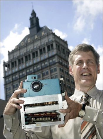 Eastman Kodak Co. headquarters in Rochester, N.Y - Steven Sasson holds the prototype digital camera he built in 1975 at the Eastman Kodak. It recorded a black-and-white image on a digital cassette tape. Photo: Associated Press    Read more: http://www.seattlepi.com/business/article/Kodak-engineer-had-revolutionary-idea-the-first-1182624.php#ixzz245E6TeVl