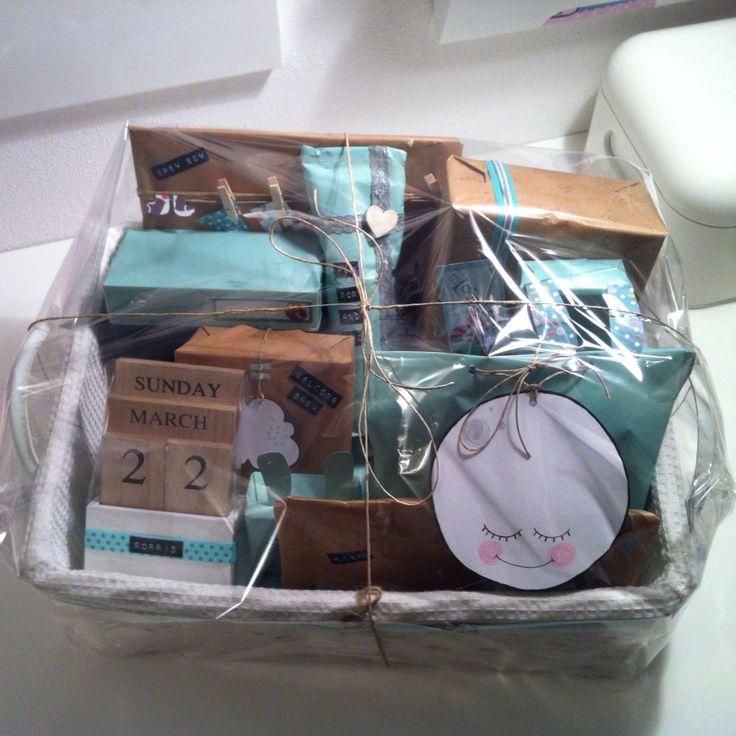 Creatief inpakken bijvoorbeeld cadeautjes leuk inpakken voor een kraammand