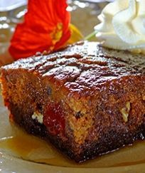 Cape brandy pudding. Date Mixture Ingredients: 250g stoned dates 250ml boiling water 5ml bicarbonate of soda Pudding Ingredients: 100g Stork Bake 1 egg 250ml brown sugar 315ml flour 2.5ml baking powder 125ml chopped pecan nuts 150ml brandy 125ml chopped cherries Sauce Ingredients: 250ml sugar 125g Stork Bake 125ml cream 125ml brandy Cream, for serving