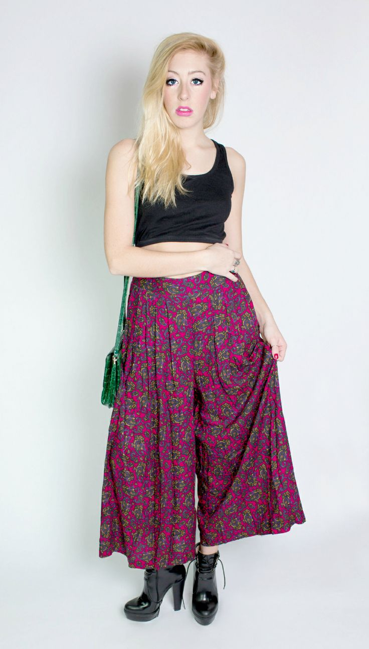 These high waisted paisley vintage palazzo pants are super rad. High-waisted, with gold accent buttons and deep pockets, these pants have enough movement and volume to keep the party going all night long.