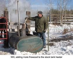 Image result for wood burning stock tank heater