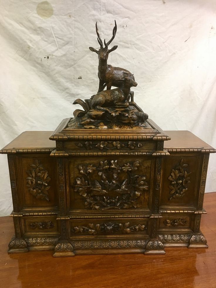 Antique German walnut humidor cabinet. With carvings on each side and deer mounted on top . inside containing wooden slides and holding 128 cigars.