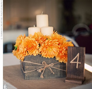 Centerpiece. Orange. Brown. Candles and Burlap