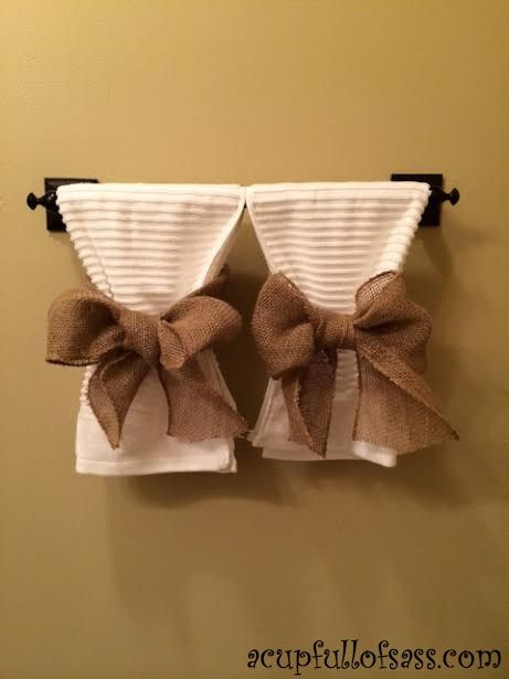 tie burlap bows around white hand towels. Cute for guest bedroom or a half bathroom