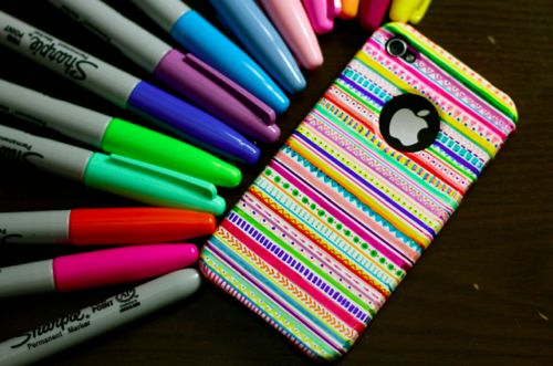Make your own Iphone case ! Buy a white Iphone case and color it with permanent markers. I love it ! <3