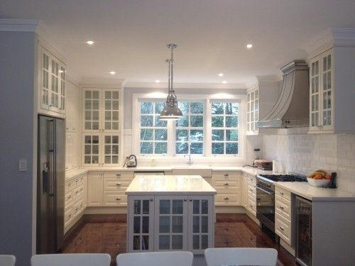 This is a stylish kitchen with a view. LIDINGO doors from IKEA.