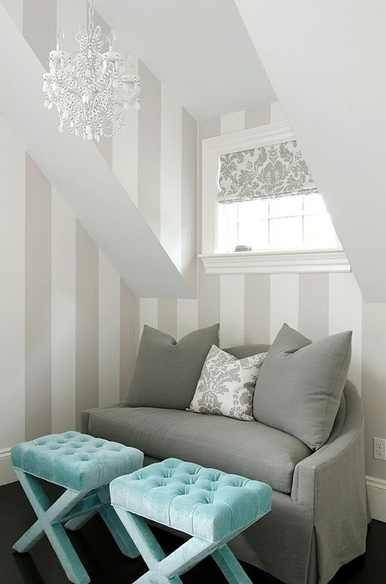 Love the combination of grey, white and turquoise along with subtle patterns and chandelier.