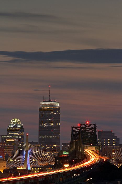 Traveling to Boston featuring skyline photography from award winning Boston fine art photographer Juergen Roth. The Boston skyline images was taken from Malone Park in Chelsea, MA and shows familiar skyscraper landmarks such as Boston Prudential Tower, 111 Huntington Avenue and famous bridge architecture such as the Bunker Hill Bridge and Mystic River Bridge captured on a beautiful sunset night at twilight.   Good light and happy photo making!   My best,   Juergen www.RothGalleries.com