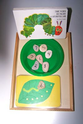 Counting with The Very Hungry Caterpillar.  Make leaves with holes punched in to match the numbered rocks (or any other counter you want)