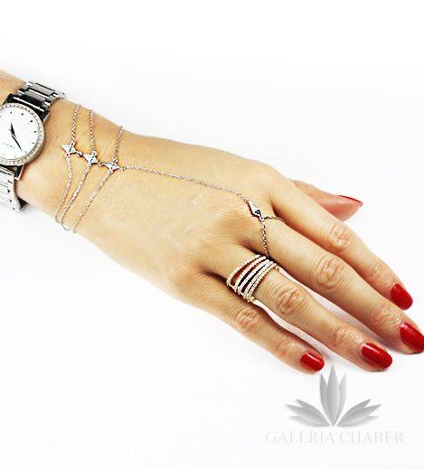 Nowość, orientalna bransoletka zapinana na nadgarstku z miejscem na palec. Wykonana ze srebra próby 925, rodowana, wysadzana cyrkoniami o szlifie brylantowym. Długość bransoletki to około 14-17 cm - regulacja. Długość samego wzoru ozdobnego to około 3,5 cm.