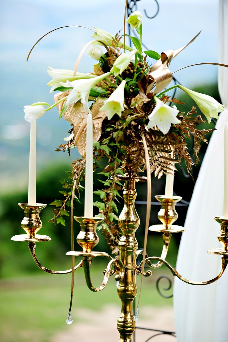 For the ceremony we topped 1.2m gold candelabra with white & gold arrangements.