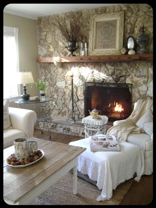 Fireplace that takes up an entire wall and a very simple mantle via The Old Painted Cottage.  Super cozy!