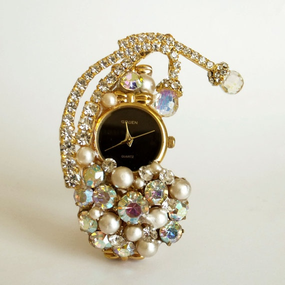 Working..Retro watch revamped by me with vintage jewelry and rhinestones.