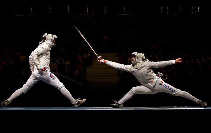 Sabre action moment ! Ya, unbelievable lunge, with head cut that looks good... always enjoyed  the sabre...