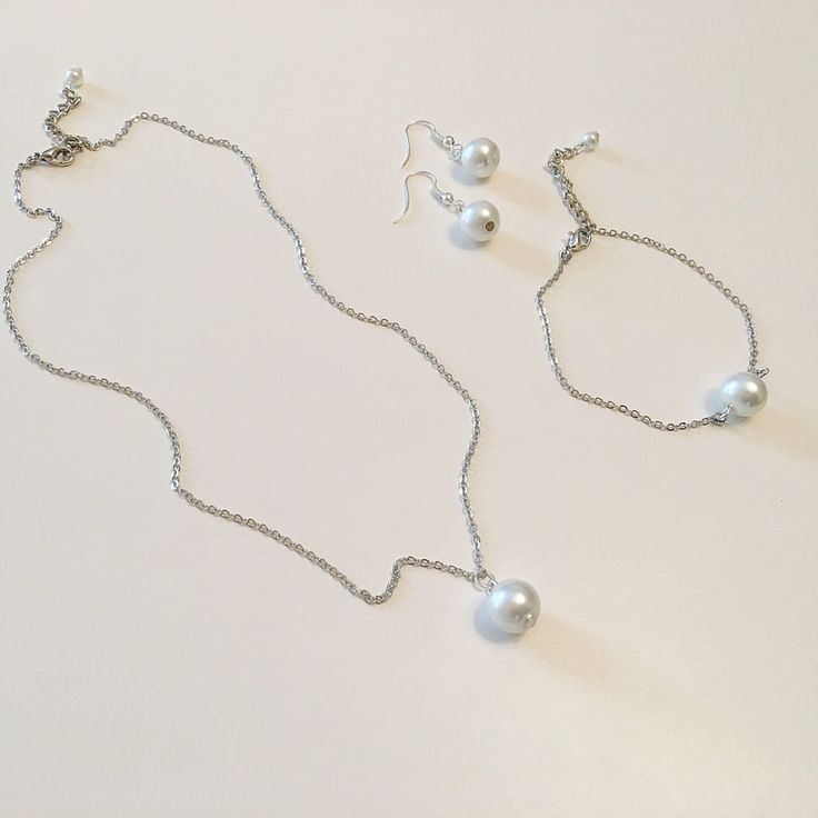 A personal favorite from my Etsy shop https://www.etsy.com/listing/186536560/pearl-set-white-ivory-pearl-jewelry