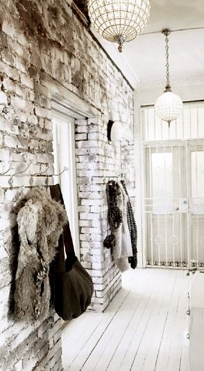= exposed bricks, white painted floors and coat hooks