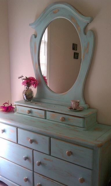 Formerly a little girl's dresser...Now all grown up in a  shabby Robin's egg blue.  J.Sayre 2011